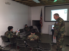 Major Jim McNab teaches an AE class to cadets